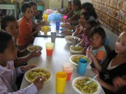 A picture of school children enjoying a Christmas meal